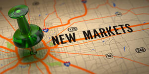 New Markets Concept - Green Pushpin on a Map Background with Selective Focus.-1